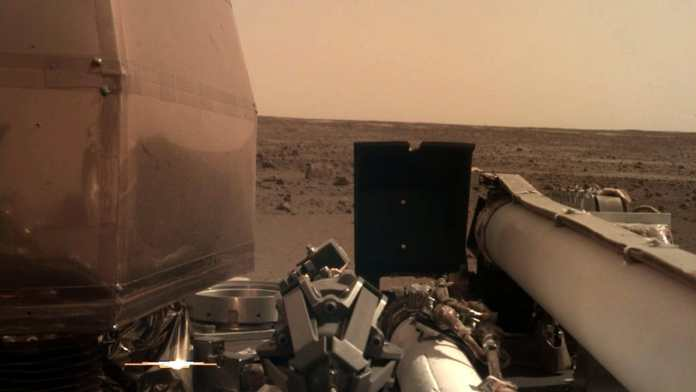 InSight took this image using its robotic arm-mounted, Instrument Deployment Camera (IDC) on the day it landed. All the instruments in the frame are parts of the lander's onboard experiments. Image courtesy: NASA