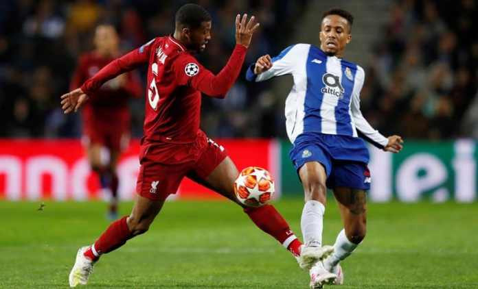 FC Porto's Eder Militao challenges Liverpool midfielder Georginio Wijnaldum during a Champions League match. Reuters