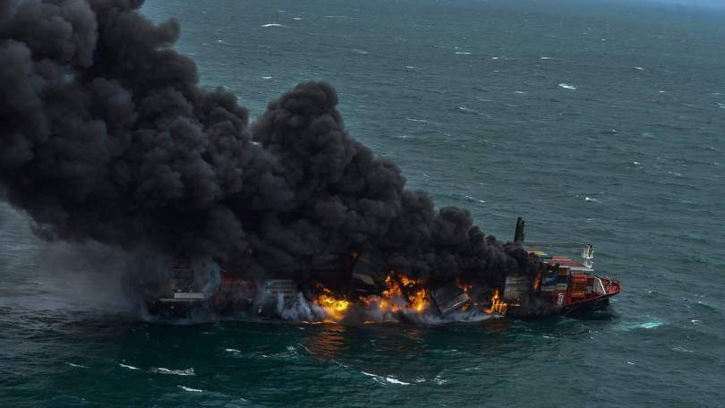 Smoke rises from a Singaporean flag container ship MV X-Press Pearl that engulfed in fire anchors off Colombo port, Sri Lanka on Tuesday, May 25, 2021. (AP Photo/HO, Sri Lanka Air Force)