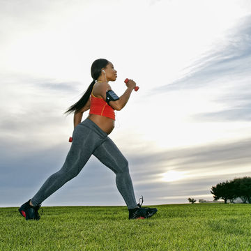 pregnant woman walking with hand weights