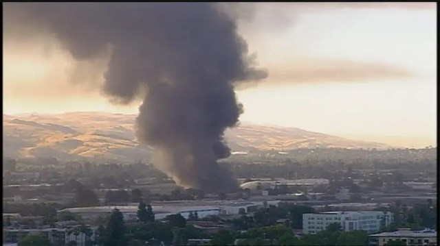 View of a fire in San Jose that is believed to be linked to the shooter who opened fire at a VTA facility in San Jose