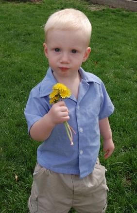 Boy holding flower