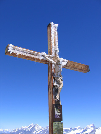 Christ crucifix in snow, Switzerland