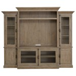 Magnussen Home Tinley Park Relaxed Vintage Entertainment Wall Unit With Glass Doors And 3 Way Touch Lighting Esprit Decor Home Furnishings Wall Unit