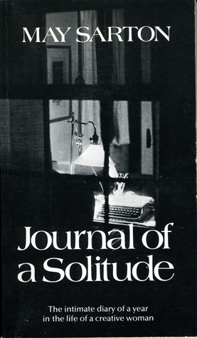 The black-and-white cover of Journal of a Solitude by May Sarton featuring a photograph of a desk illuminated by a lamp, as viewed through a window.