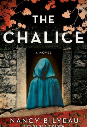 Book cover of The Chalice by Nancy Bilyeau: back of a cloaked figure standing in front of an open doorway in a stone building