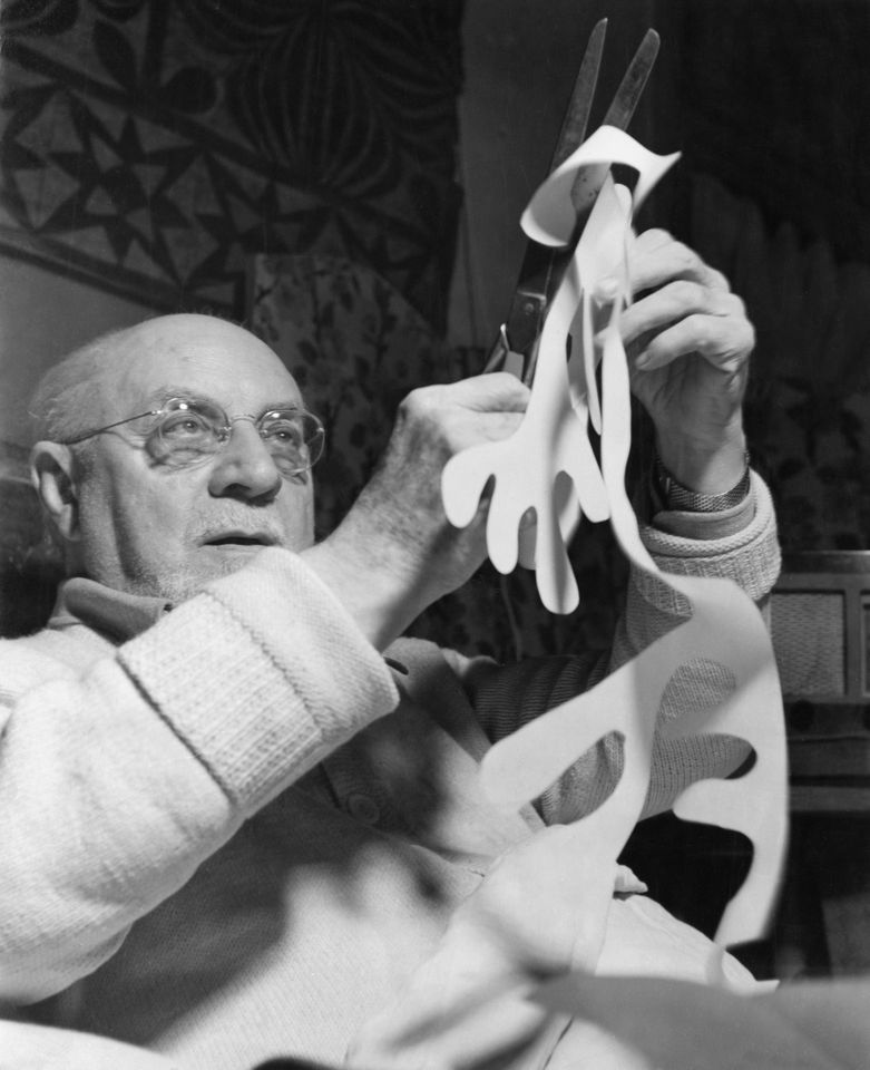 Henri Matisse making paper cut-outs in bed at his home in Vence, France, in the late 1940s