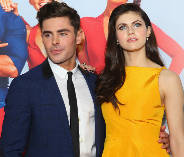 Zac Efron denied that he and co-star Alexandra Daddario are dating in the most flirty way possible