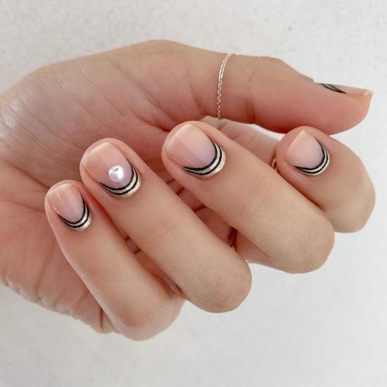 Crescent nails are one of 2019's hottest low-key beauty trends