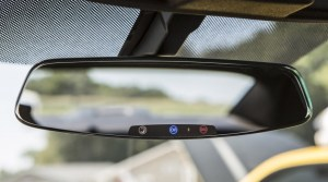 Image: 2013 Chevrolet Camaro's frameless rearview mirror with electrochromic OnStar buttons