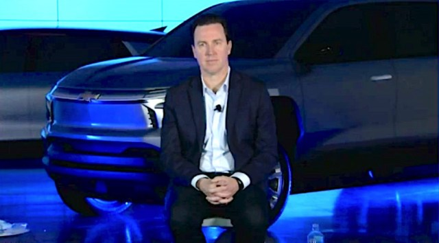 GM chief EV officer Travis Hester with Chevrolet electric truck
