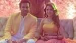 Sanket Bhosale and Sugandha Mishra pose for a photo together.