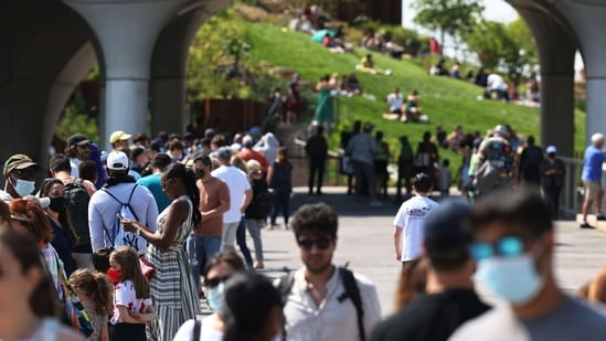 People wait in line to enter the Little Island public park on Hudson River Park in Manhattan on May 21, 2021 in New York City. The Little Island public park on 13th Street in Hudson River Park opened for the first time to the public on Friday. The features 350 different flowers, trees and shrubs. A 687-seat amphitheater with independent arts programming starting in June. The park also has space for seating for food and beverages from vendors. (AFP)