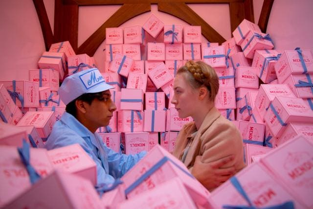 Wes Anderson's 2014 film The Grand Budapest Hotel follows a tight visual palette. You can look for film stills by colour on Flim.ai to find other movies that match this hue. (Image courtesy Fox Searchlight Pictures)