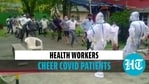 Health workers cheer covid patients
