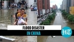 China: Deadly floods kill over 20; people stuck in subway rescued; dams damaged