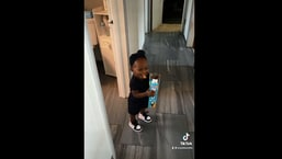 The image shows the little girl whose dad caught her stealing snacks.