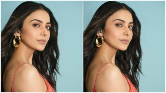 For this photoshoot, Rakul Preet played muse to the designer house Saaksha and Kinni and chose a coral dress from their wardrobe. The midriff-baring floral printed satin dress hugs her body perfectly.(Instagram/@rakulpreet)
