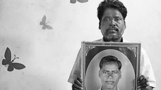 Ramesh Sundaram holds up an image of his late brother Kalyan Sundaram. Also from The First Witnesses. Jodha says his photography is a reflection of his legacy, a reference to the famine research conducted by his late father, agricultural economist NS Jodha, and referenced in books by economists such as Amartya Sen and Jean Drèze.(Photo: Vijay S Jodha)
