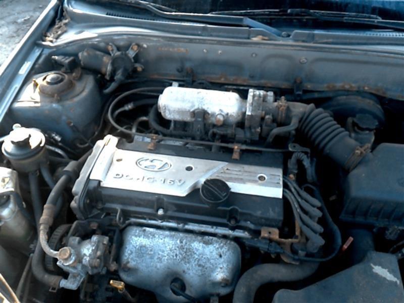 [1996 Hyundai Accent Coolant Reservoir Removal]