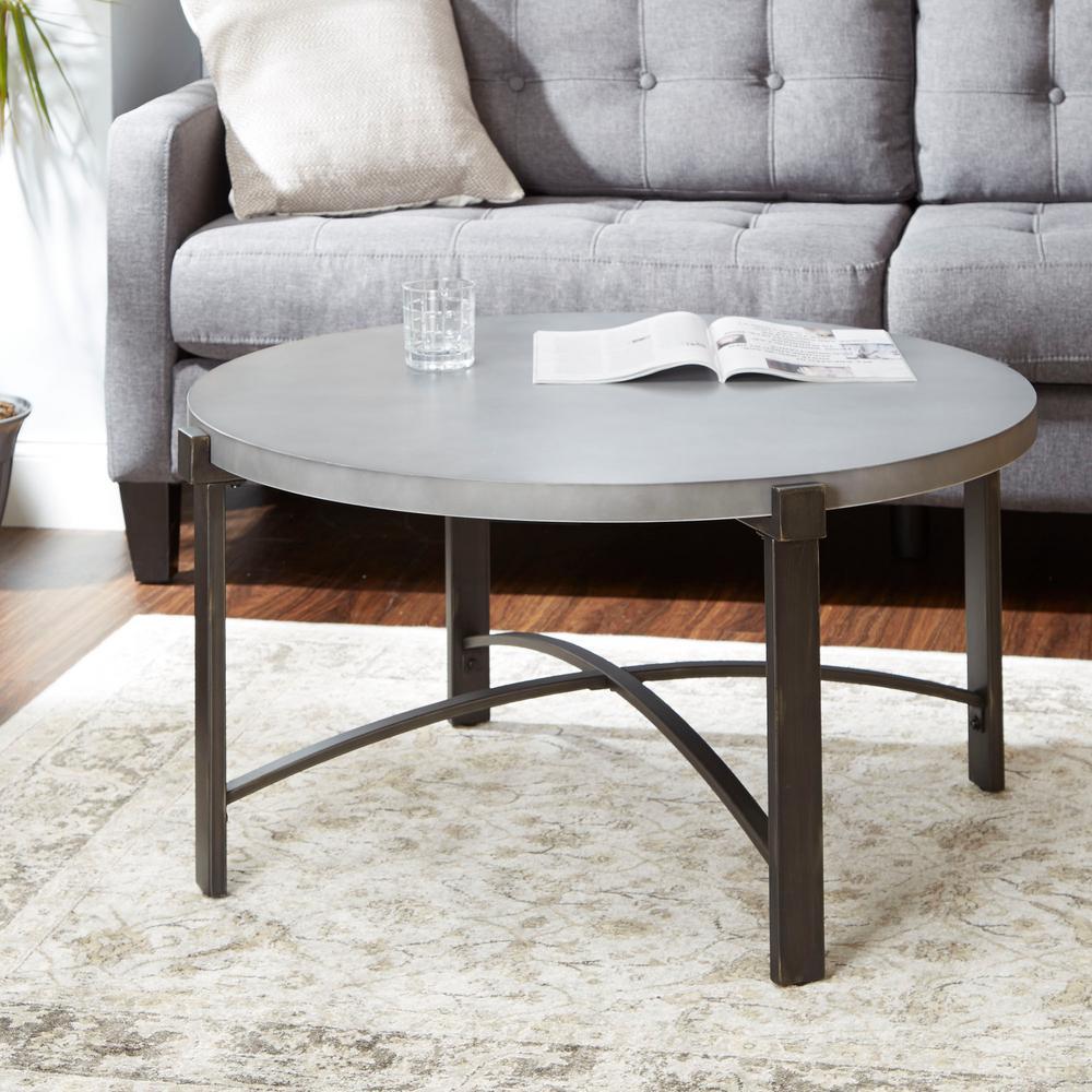 lewis 38 in bronze medium round stone coffee table