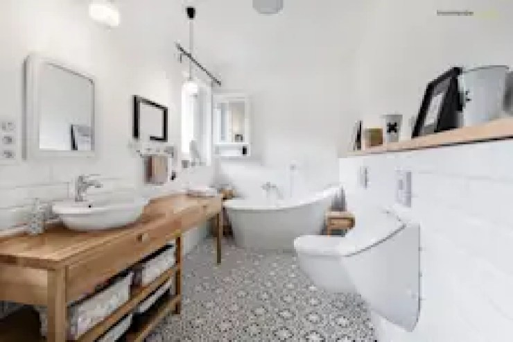 Baños de estilo escandinavo de PracowniaPolka