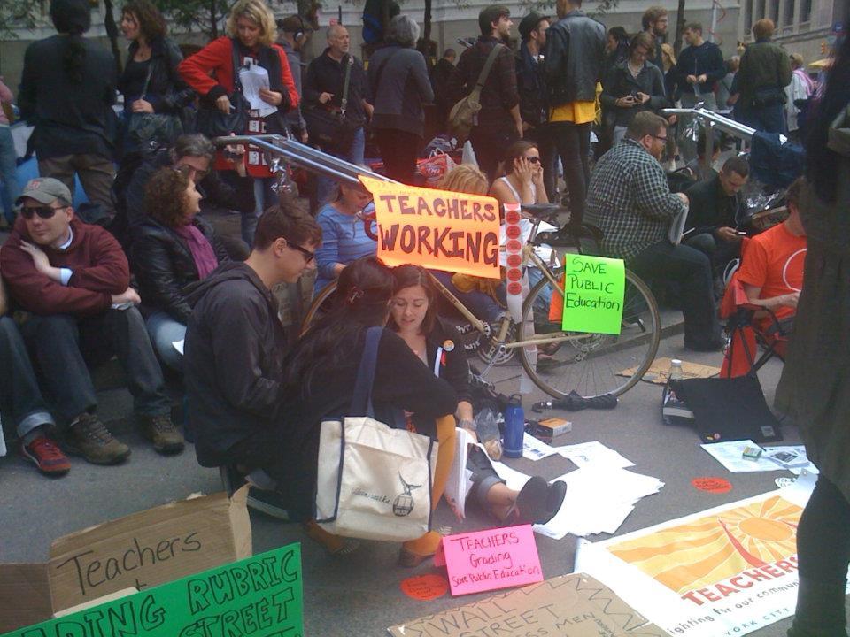 2011-10-06-OccupyWallStreet_TeachersGradingPapers.jpg