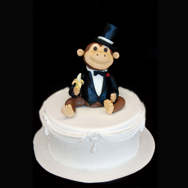 2013-06-11-2monkeycaketopper_pinkcakebox.jpg