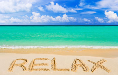 relax written on beach