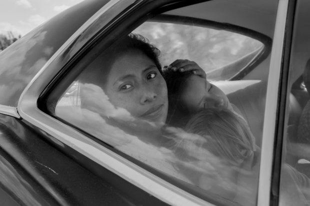 Yalitza Aparicio as Cleo, Marco Graf as Pepe, Carlos Peralta Jacobson as Paco, and Daniela Demesa as Sofi in Roma, written and directed by Alfonso Cuarón. Image by Alfonso Cuarón.