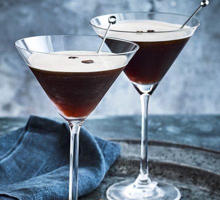 Espresso martinis in glasses with stirrers
