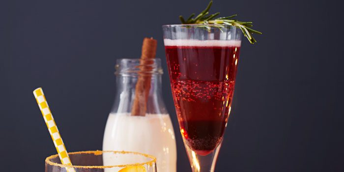 Cocktail with rosemary sprig on tray