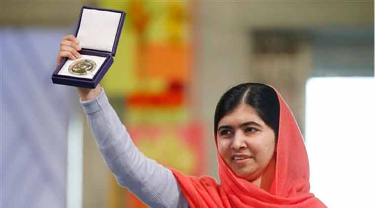 Nobel Peace Prize winners Malala Yousafzai from Pakistan holds up her medal during the Nobel Peace Prize award ceremony in Oslo (Source: AP)