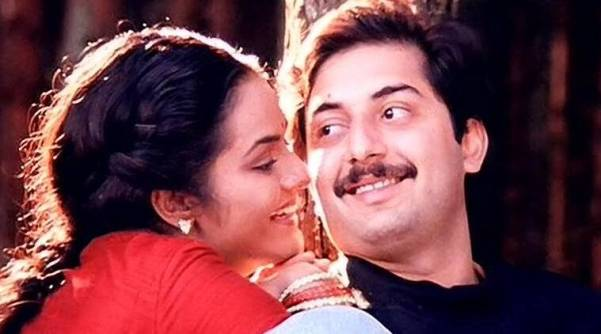 Madhoo and Arvind Swamy play a married couple whose world is shattered when the husband is kidnapped by militants. (Credit: indianexpress.com)