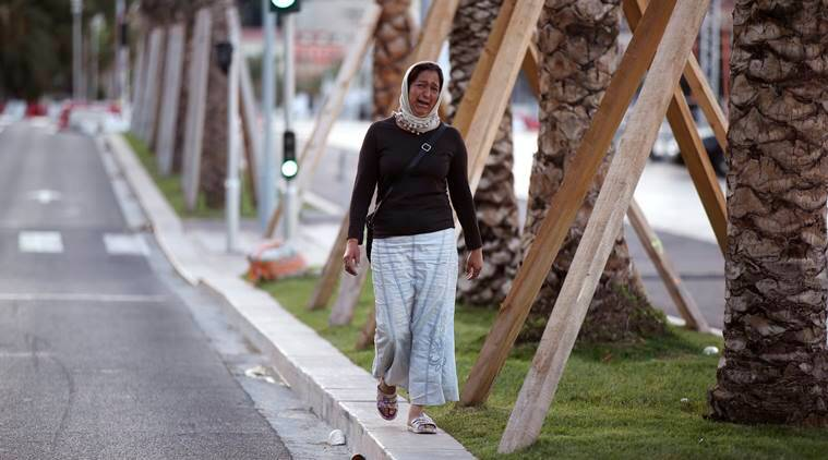 A woman cries asking for her son as she walk near the scene of an attack after a truck drove onto the sidewalk and plowed through a crowd of revelers who'd gathered to watch the fireworks in the French resort city of Nice. (Source: Reuters)