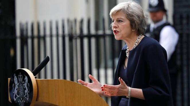 New British Prime Minister Theresa May speaks to the media as she arrives at her official residence,10 Downing Street in London, Wednesday July 13, 2016. David Cameron stepped down Wednesday after six years as prime minister. (AP Photo/Frank Augstein)