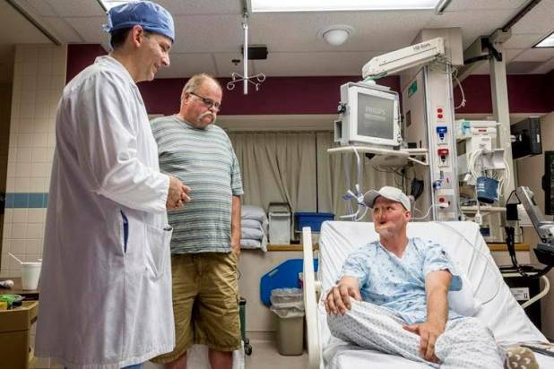 Andy Sandness spoke to his father, Reed Sandness, and Dr Samir Mardini, before the face transplant procedure at the Mayo Clinic in Rochester, Minn. (Eric M. Sheahan/Mayo Clinic via AP)