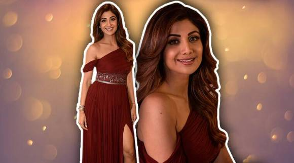 Shilpa Shetty misses the mark in this burgundy thigh-high slit gown; see pics