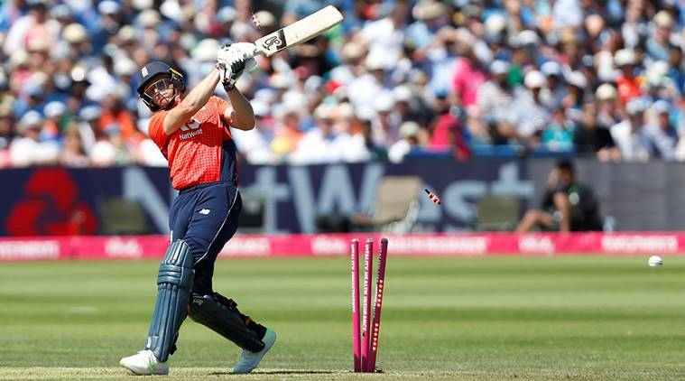 England's Jos Buttler loses his wicket bowled out by India's Siddarth Kaul