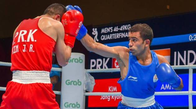Asian Games  Gritty Vikas Krishan  dominant Amit Panghal into boxing     Jakarta  India s Amit Panghal  Blue  and PR Korea s Ryong Jong compete in  the Men s Light Fly  46 49kg  Quarterfinal boxing event in the 18th Asian  Games