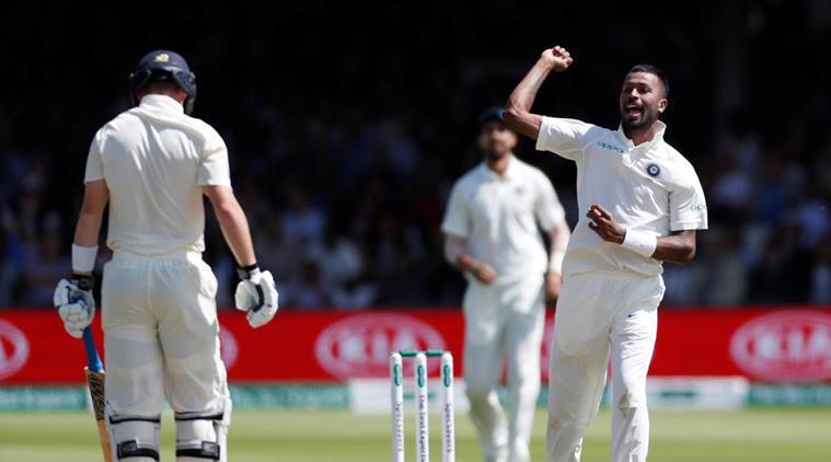 India's Hardik Pandya celebrates after taking the wicket of England's Ollie Pope