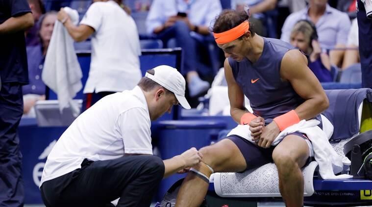 Rafael Nadal, of Spain, is treated by a trainer during a change over against Juan Martin del Potro, of Argentina, during the semifinals of the U.S. Open tennis tournament