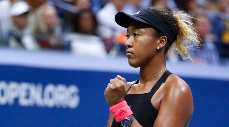 Naomi Osaka, of Japan, reacts after winning the first set against Serena Williams during the women's final of the U.S. Open tennis tournament