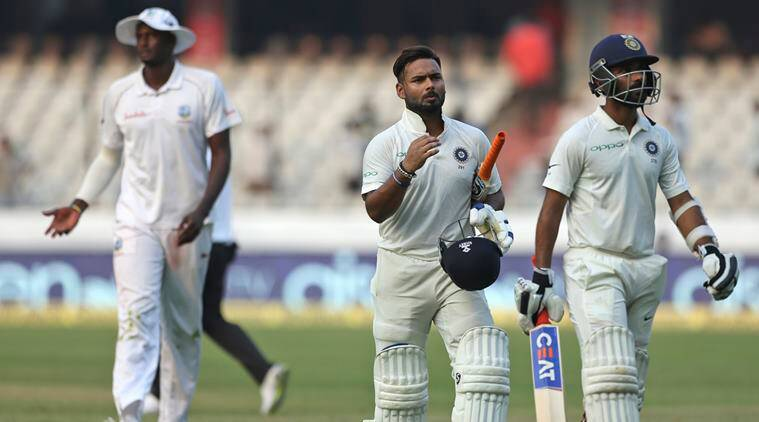 Indian cricketer Rishabh Pant and Ajinkya Rahane, right, walk off the field at the end of the second day of the second cricket test match between India and West Indies in Hyderabad