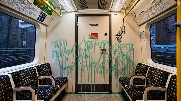 Banksy tube 759 - Banksy's latest appears inside a train compartment; gets removed hours later