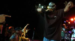 MF Doom, a masked rapper with complex rhymes, is dead at the age of 49
