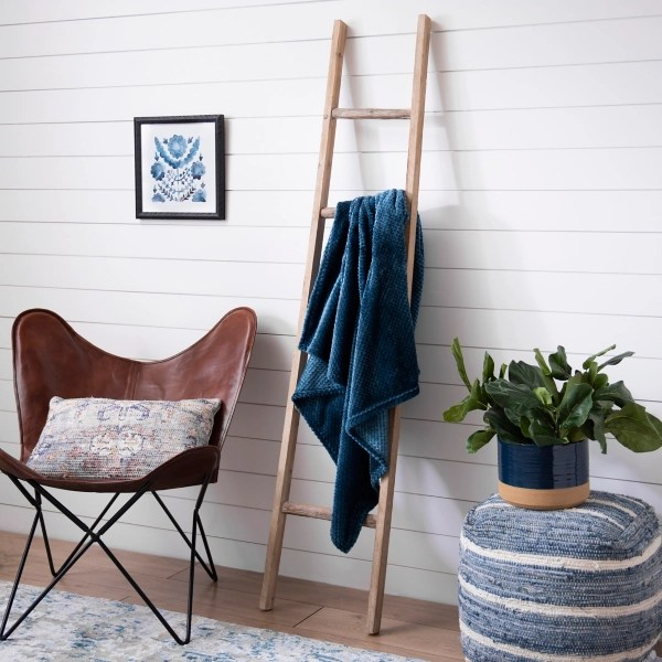 natural wood leaning ladder