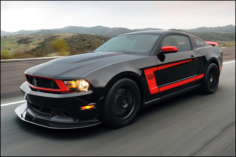 Hennessey Hpe700 Boss 302 Mustang Rips The Smile Off Shelby Gt500