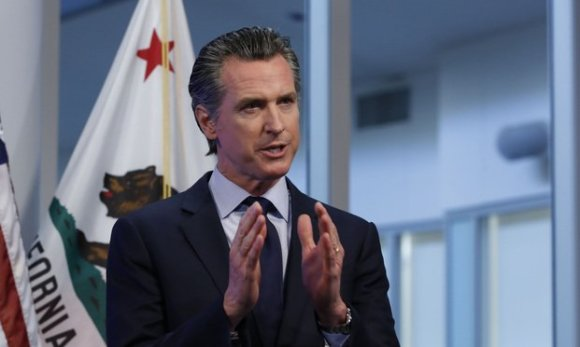 Gavin Newsom, governor of California, speaks during a news conference in Sacramento, California, U.S., on Tuesday, April 14, 2020. Newsom outlined his plan to lift restrictions in the most-populous U.S. state, saying a reopening depends on meeting a series of benchmarks that would remake daily life for 40 million residents.  Photo: Rich Pedroncelli/Bloomberg