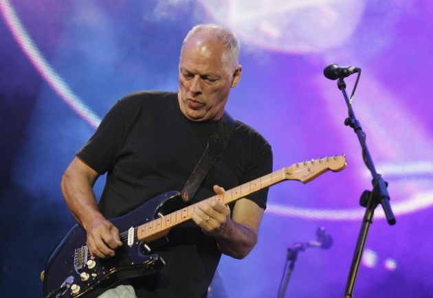 "LONDON - JULY 02: Dave Gilmour from the band Pink Floyd on stage at ""Live 8 London"" in Hyde Park on July 2, 2005 in London, England. The free concert is one of ten simultaneous international gigs including Philadelphia, Berlin, Rome, Paris, Barrie, Tokyo, Cornwall, Moscow and Johannesburg. The concerts precede the G8 summit (July 6-8) to raising awareness for MAKEpovertyHISTORY. (Photo by MJ Kim/Getty Images)"
